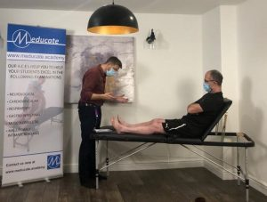 Clinical lead Pete Gorman prepares to preform a hip examination