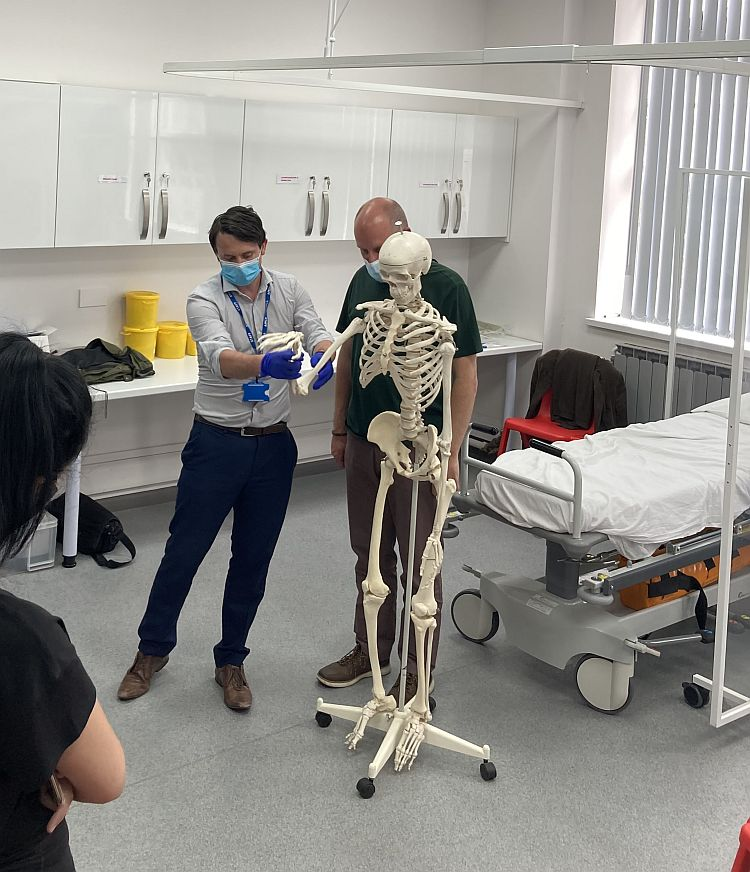 Clinical Director James Ennis demonstrates an Elbow exam with ACE Mark Reynolds